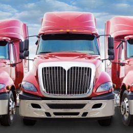 Three red trucks